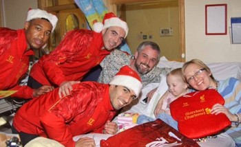 Liverpool FC's Luis Suarez meets Erin and her family during the team's 2013 Christmas visit