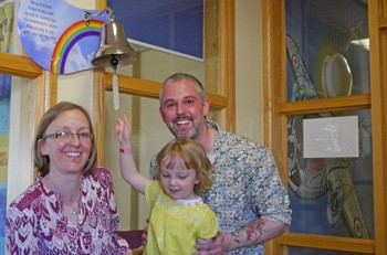 Erin rings the bell to mark the end of her treatment at Alder Hey's oncology unit
