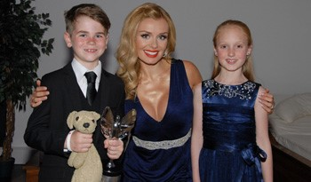 Young fundraising ambassadors Ted McCaffery and Grace Lee with Katherine Jenkins
