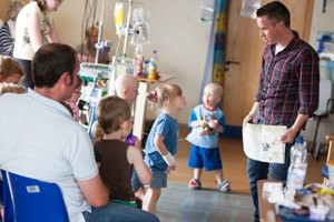 Alex Winters from CBeebies reads a story on Alder Hey's oncology ward