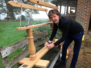 Paul McCartney signs the Stephenson Bros rocking horse with a famous lyric for the Alder Hey Children's Charity auction
