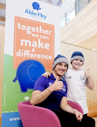 Everton FC's Leighton Baines with Alder Hey Children's Charity's young fundraising ambassador Kenzie Appleton