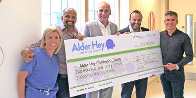 The Pinarello Bikers presented a cheque of £264,000 to Alder Hey